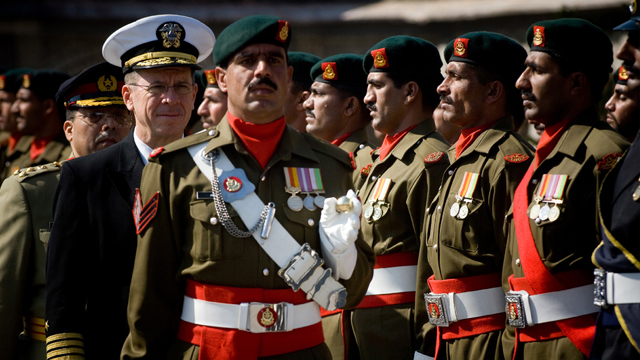 American Chairman of Joint Chiefs Admiral Mike Mullen reviews Pakistani troops during a ceremony honoring Mullen's arrival in Islamabad in 2008