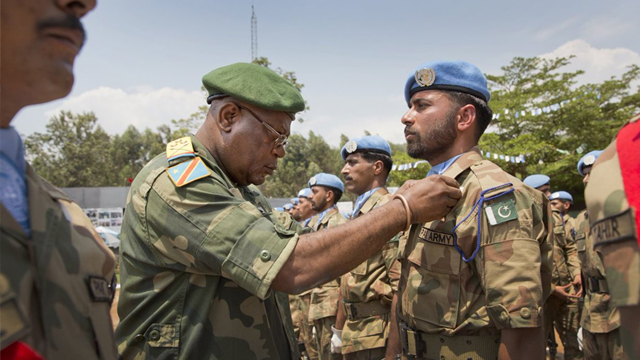 Pakistani soldiers being decorated after a tour of duty with the UN in the DR Congo